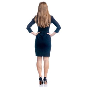 Business woman in dress and high heels standing smiling on white background isolation, rear view