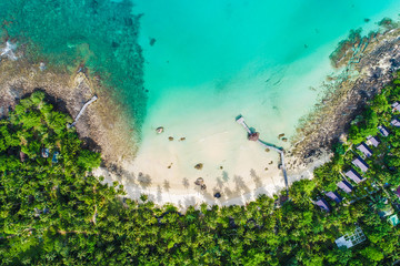 Turquoise sea water with beach on island green tropical forest