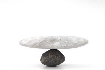 A picture of a rock standing together showing a balance on a white background.