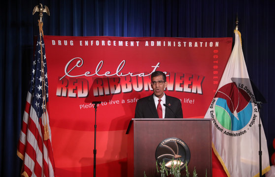 Acting DEA Chief Uttam Dhillon addresses the Drug Enforcement Agency's (DEA) National Red Ribbon Rally at DEA headquarters in Arlington, Virginia