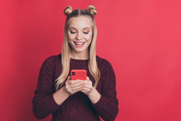 Photo of amazing influencer lady holding telephone in hands reading positive comments in blog post wear knitted jumper isolated pastel red color background