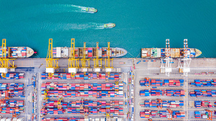 Top view of Deep water port with cargo ship and containers. It is an import and export cargo port where is a part of shipping dock and export products worldwide Wall mural