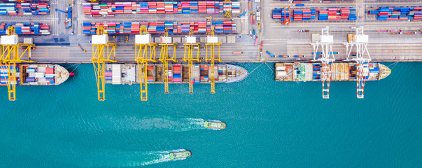 Top view of Deep water port with cargo ship and containers. It is an import and export cargo port where is a part of shipping dock and export products worldwide Fotomurales