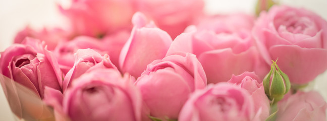 Bouquet of pale delicate peony, roses wrapped in cellophane
