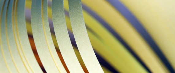 Abstract Yellow color wave curl strip paper.  Background for prints, posters, cards.