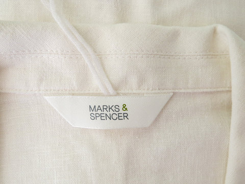 Marks and Spencer womens clothing label, close up.
