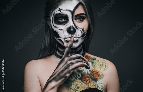 Creepy female making silence gesture