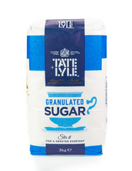 Bag of Tate and Lyle granulated sugar. White background.