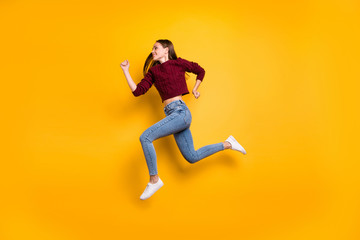 Full body profile side photo of cheerful lady running wearing marsala sweater isolated over yellow Wall mural