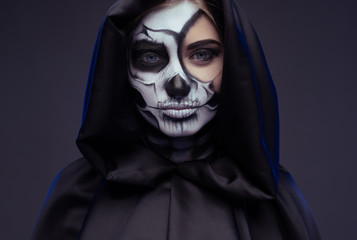 Pensive female with Halloween makeup