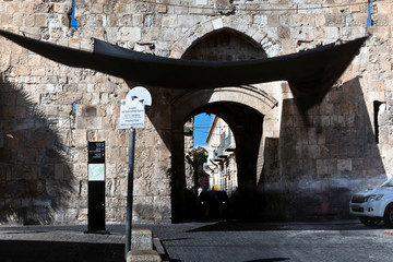 A car enters through Lions' Gate in Jerusalem's Old City