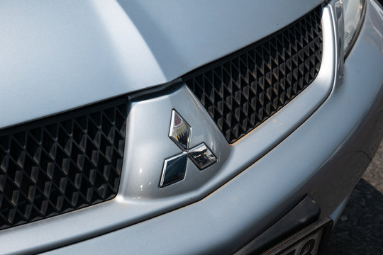 Bangkok, Thailand - September 29, 2019: Mitsubishi logo is seen on the front grill of a vehicle.