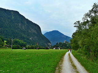 Austrian Alps-cyclists on the road to the castle Kropfsburg