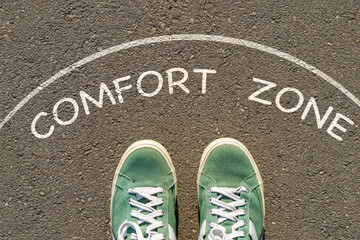 photo on top of the sneakers and the inscription comfort zone on the asphalt, the concept of personal private space