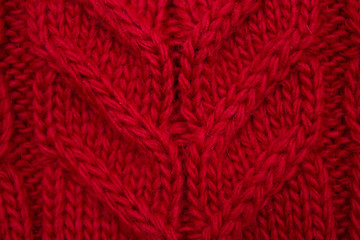Knitted background red, close-up yarn structure