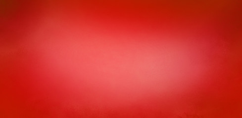 Wall Mural - Red Christmas background with soft blurred texture design, abstract blurry red background with light center and dark borders
