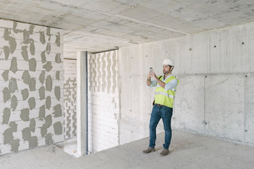 Architect taking a photo on construction site