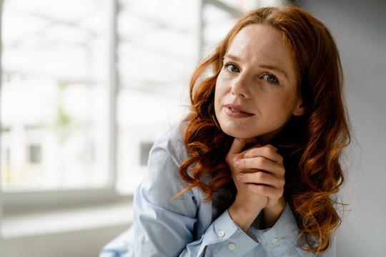 Portrait of redheaded businesswoman in a loft
