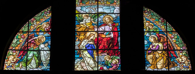 Fototapete - ARCO, ITALY - JUNE 8, 2018: The Annunciation in the stained glass  in the church Chiesa Collegiata dell'Assunta.