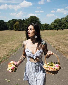Woman carries basket of flowers