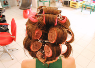 Woman's long brown hair with curlers