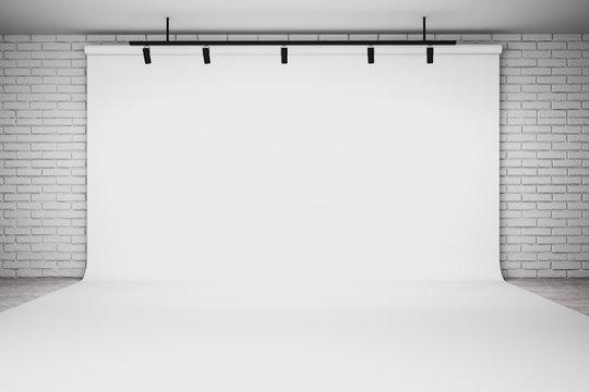 Empty white photo studio