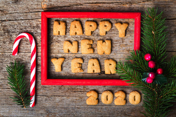 Happy new year note in a wooden frame