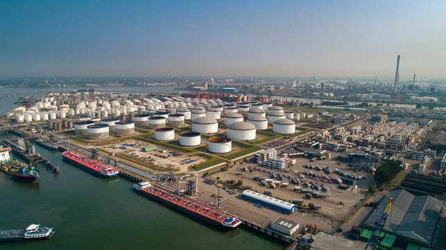 Oil refinery plant from industry zone, Aerial view oil and gas industrial, Refinery factory oil storage tank and pipeline steel