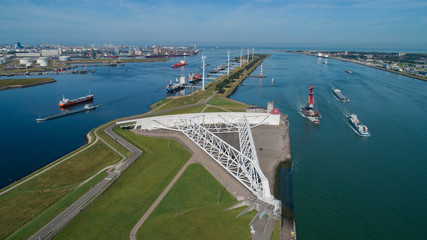 Photo sur Aluminium Rotterdam Aerial picture of Maeslantkering storm surge barrier on the Nieuwe Waterweg Netherlands it closes if the city of Rotterdam is threatened by floods and is one of largest moving structures on earth