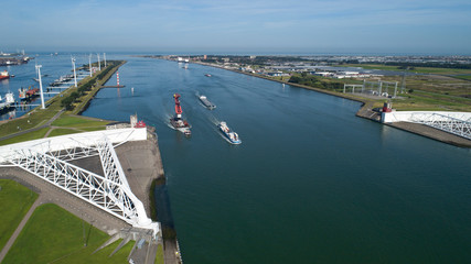 Deurstickers Rotterdam Aerial picture of Maeslantkering storm surge barrier on the Nieuwe Waterweg Netherlands it closes if the city of Rotterdam is threatened by floods and is one of largest moving structures on earth