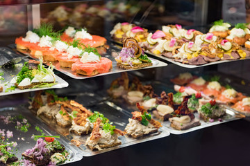 Danish smorrebrod traditional open sandwich at Copenhagen food market store. Many sandwiches on...
