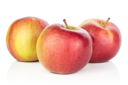 Group of three whole red apple jonagold isolated on white background