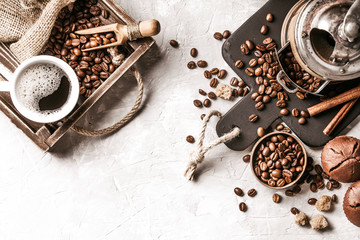 Fototapete - Coffee with  coffee beans on grey textured background. Top view with copy space. Background with free text space.