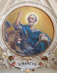 Wall Mural - BELAGGIO, ITALY - MAY 10, 2015: The freso of St. Mark the Evangelist in church Santa Maria Annunciata (Visgnola) Luigi Morgari (20. cent.).