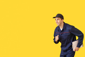 Running car mechanic on color background