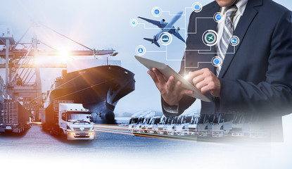The double exposure image of the Businessman manager using tablet check and control during sunrise overlay with Logistics and transportation of Container Cargo ship and Cargo plane