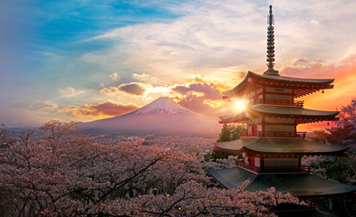 Wall Murals Place of worship Fujiyoshida, Japan Beautiful view of mountain Fuji and Chureito pagoda at sunset, japan in the spring with cherry blossoms