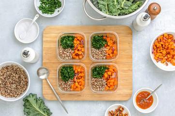 Preparing healthy vegetarian food ahead in lunch boxes, top down view