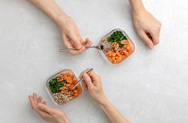 Home prepared healthy eating concept,  top down view on office kitchen table with healthy food in lunch boxes