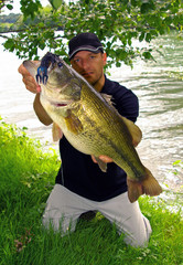 Bass fishing, man holding a big bass. Lure fishing