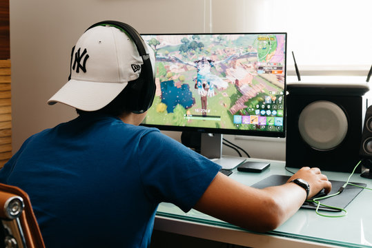 Teenager playing Fortnite video game