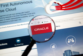Oracle home page under magnifying glass.