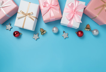 Colorful gift boxes decoration on blue isolated background with copy space. Christmas, Birthday and New year concept.