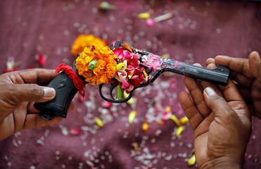 Police officers offer prayers to their weapons on the occasion of Dussehra in Ahmedabad