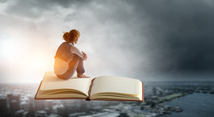 Little woman with large book concept