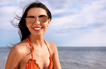 Beautiful young woman in bikini on beach