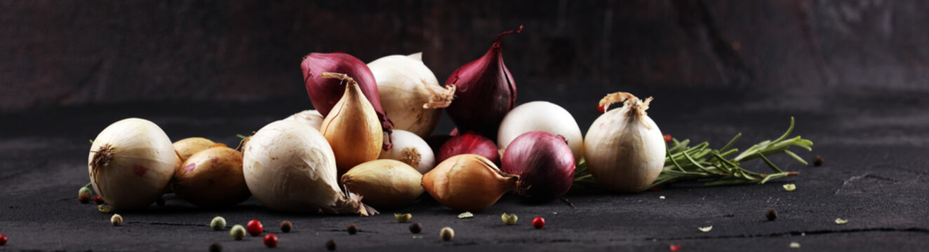 different onions on rustic table