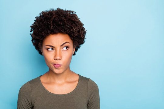 Hmm... interesting. Portrait of serious expression emotions minded afro american girl think try to solve decide solutions be creative wear good look outfit isolated over blue color background