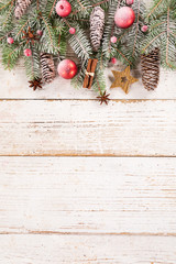 Christmas decoration on wooden background, lots of copy space for product or text.