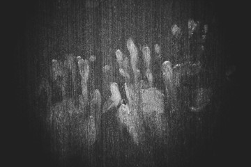 Hand marks on wooden wall - hand prints Horror scary dirty fingerprint The concept of loneliness and abandonment and Horror scary Ghost in home door on Halloween